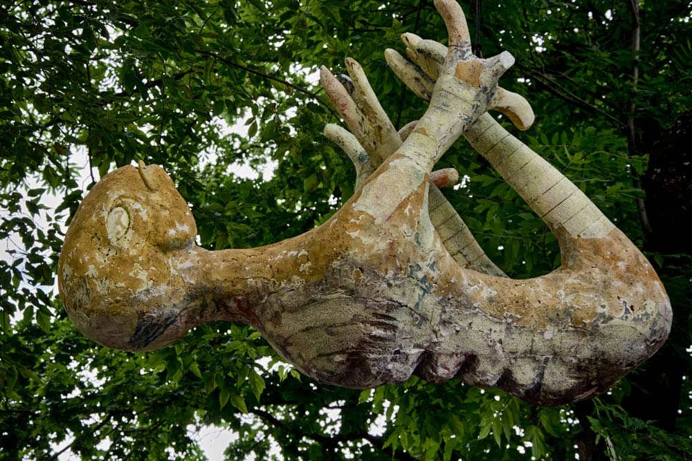 Hanging Alien Sculpture in Užupis, Vilnius, Lithuania